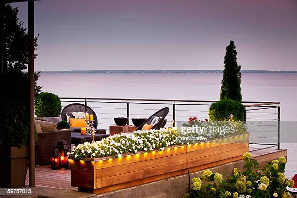 patio over looking the lake at sunset. - waterfront stock pictures, royalty-free photos & images