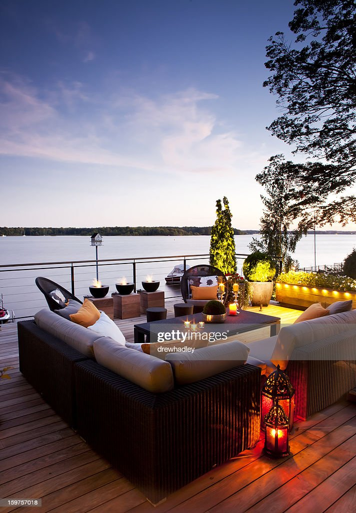 Patio over looking the lake at sunset. : Stock Photo