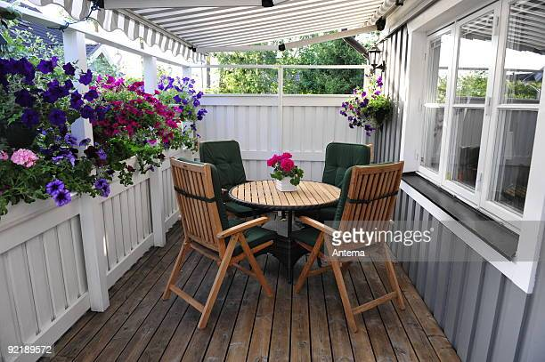 Patio with furniture and flowers