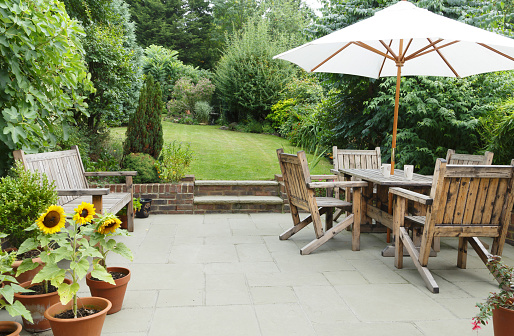 Patio with garden furniture and parasol 1132794287