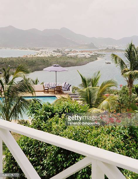 patio with pool overlooking bay - fernando bengoechea stock pictures, royalty-free photos & images