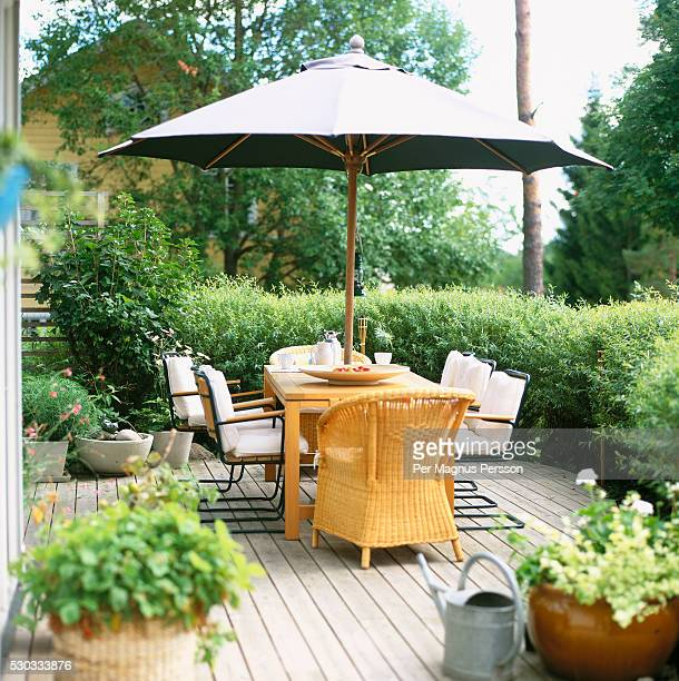Patio with table, chairs and umbrella
