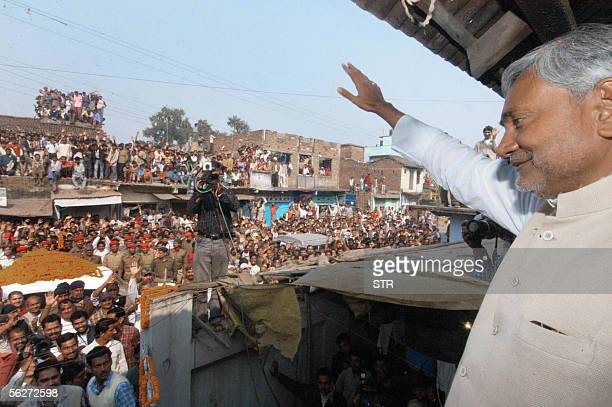 Indian Chief Minister Nitish Kumar waves to the crowd at a rally in Bakhtiyarpur in the eastern Indian state of Bihar 25 November 2005 Kumar led an...