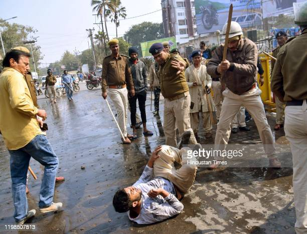 Patna police personnel lathi change to disperse a protest by Bihar Police candidates near Gandhi Maidan on February 4 2020 in Patna India Bihar...