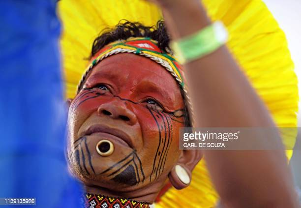 TOPSHOT Patone of the Pataxo tribe poses for a photo at a camp for indigenous protestors in Brasilia Brazil on April 24 2019 Approximately 2000...