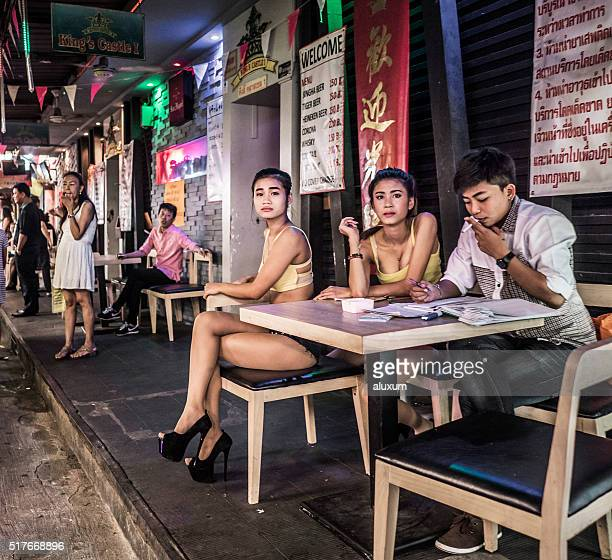 patpong bangkok thailand - red light district stock photos and pictures