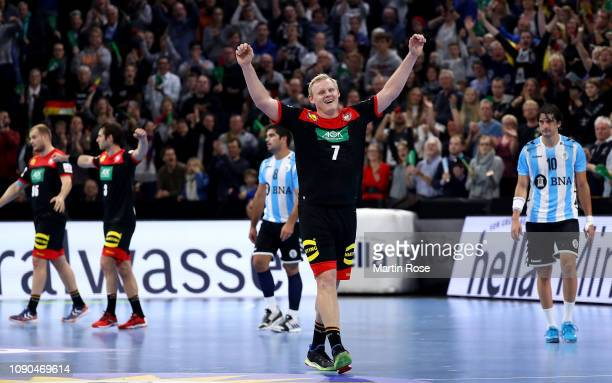 Patrcik Wienczek of Germany celebrates victory over Argentina after the International Handball Friendly match between Germany and Argentina at...