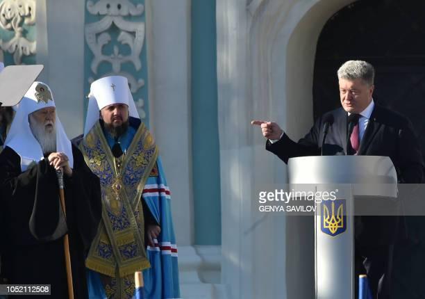 Patriarch Filaret of the Ukrainian Orthodox Church of Kiev's Patriarchy listens to Ukrainian President Petro Poroshenko during a gathering for a mass...