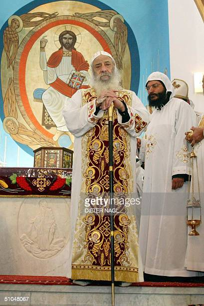 Patriarch of Egypt's Coptic Christian minority Pope Shenouda is pictured at a newly built Coptic church 11 July 2004 in Vienna on the last day of his...