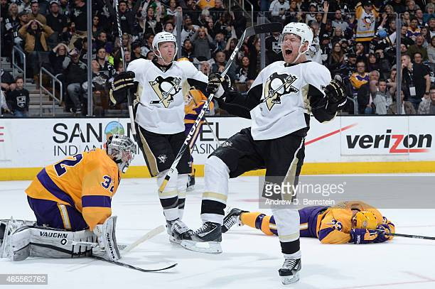 Patric Hornqvist and Paul Martin of the Pittsburgh Penguins celebrate as Jonathan Quick of the Los Angeles Kings looks on at STAPLES Center on March...