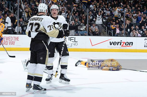 Patric Hornqvist and Paul Martin of the Pittsburgh Penguins celebrate after a game against the Los Angeles Kings at STAPLES Center on March 07 2015...