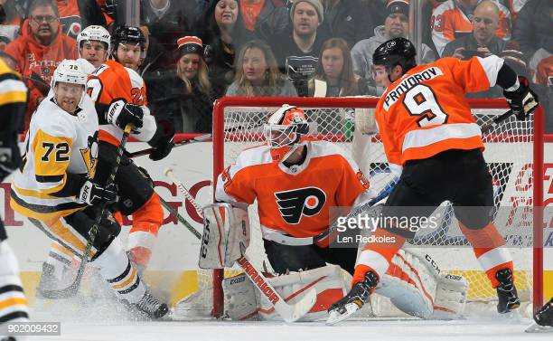 Patric Hornqvist and Sidney Crosby of the Pittsburgh Penguins battle for position against Claude Giroux Brian Elliott and Ivan Provorov of the...