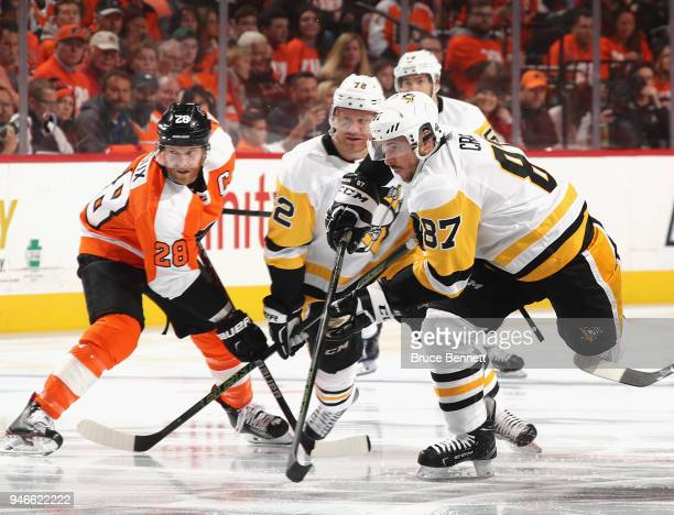 Patric Hornqvist and Sidney Crosby of the Pittsburgh Penguins skates against the Philadelphia Flyers during the first period in Game Three of the...