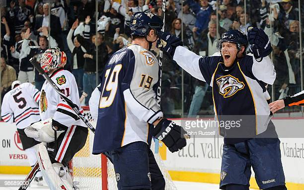 Patric Hornqvist celebrates a goal with Jason Arnott of the Nashville Predators against Antti Niemi of the Chicago Blackhawks in Game Six of the...