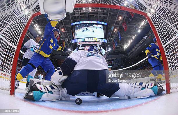 Patric Hornqvist of Team Sweden celebrates a second period goal by Nicklas Backstrom against Jaroslav Halak of Team Europe at the semifinal game...