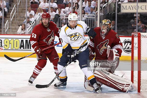 Patric Hornqvist of the Nashville Predators attempts to deflect a shot on goaltender Mike Smith of the Phoenix Coyotes in Game One of the Western...