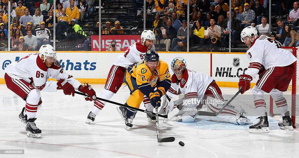 Patric Hornqvist #27 of the Nashville Predators battles for the puck against Mike Ribeiro #63 of the Phoenix Coyotes during an NHL game at Bridgestone Arena on April 10, 2014 in Nashville, Tennessee.