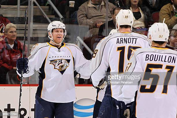 Patric Hornqvist of the Nashville Predators celebrates with teammates after scoring a second period goal against the Phoenix Coyotes during the NHL...