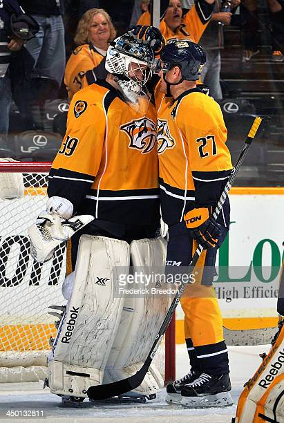 Patric Hornqvist of the Nashville Predators congratulates teammate goalie Marek Mazanec on his first career NHL win against the Chicago Blackhawks at...