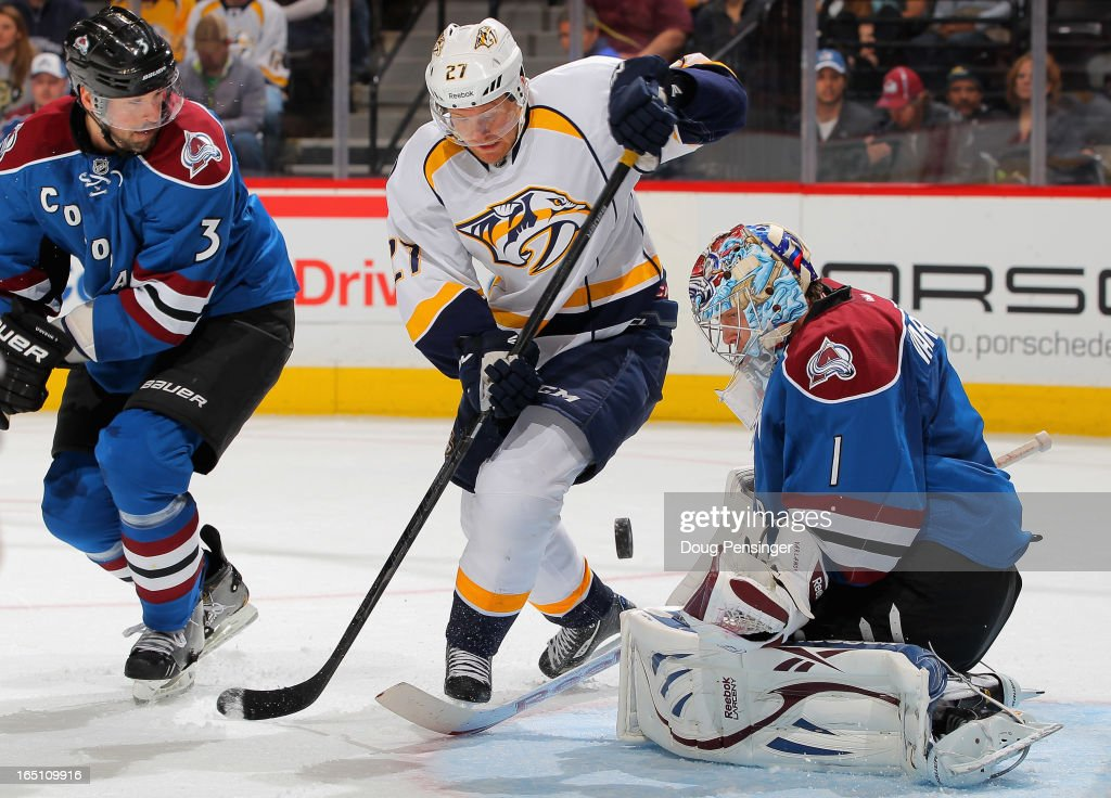 Patric Hornqvist #27 of the Nashville Predators looks to collect the puck as goalie Semyon Varlamov #1 of the Colorado Avalanche defends the goal and Ryan O'Byrne #3 of the Colorado Avalanche follows the play at the Pepsi Center on March 30, 2013 in Denver, Colorado.