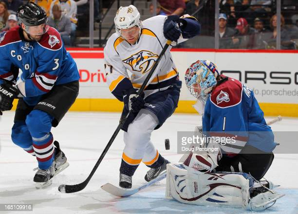 Patric Hornqvist of the Nashville Predators looks to collect the puck as goalie Semyon Varlamov of the Colorado Avalanche defends the goal and Ryan...