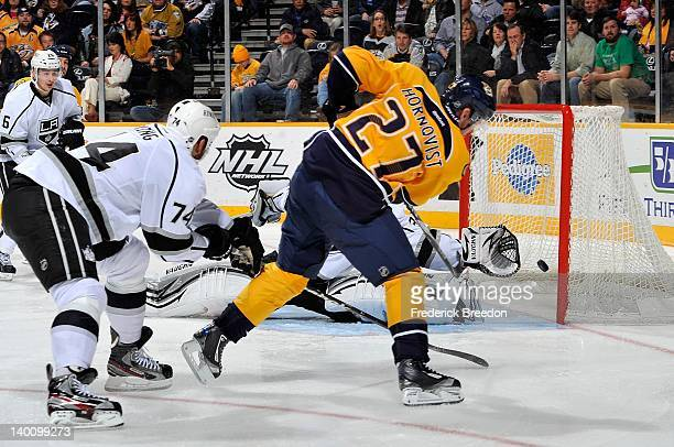 Patric Hornqvist of the Nashville Predators scores a goal against Jonathan Quick of the Los Angeles Kings at the Bridgestone Arena on February 27...