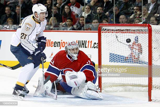 Patric Hornqvist of the Nashville Predators shoots the puck wide of Carey Price of the Montreal Canadiens during the NHL game at the Bell Centre on...