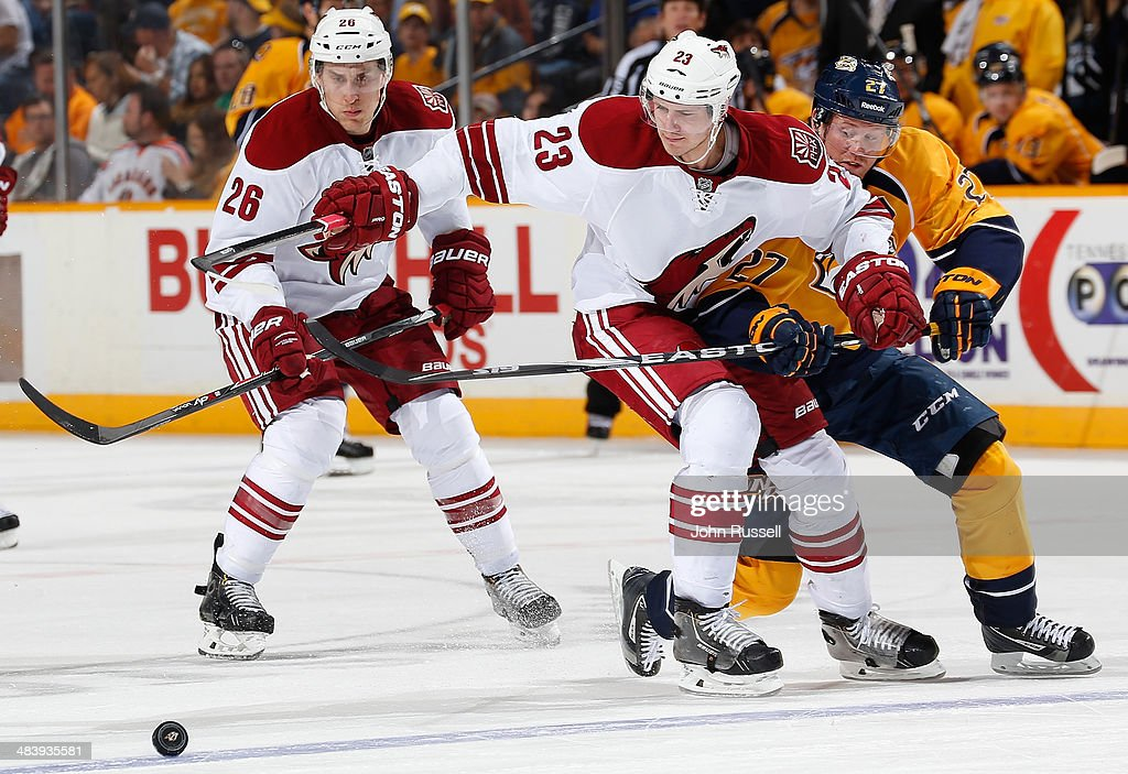 Patric Hornqvist #27 of the Nashville Predators skates against Oliver Ekman-Larsson #23 of the Phoenix Coyotes during an NHL game at Bridgestone Arena on April 10, 2014 in Nashville, Tennessee.