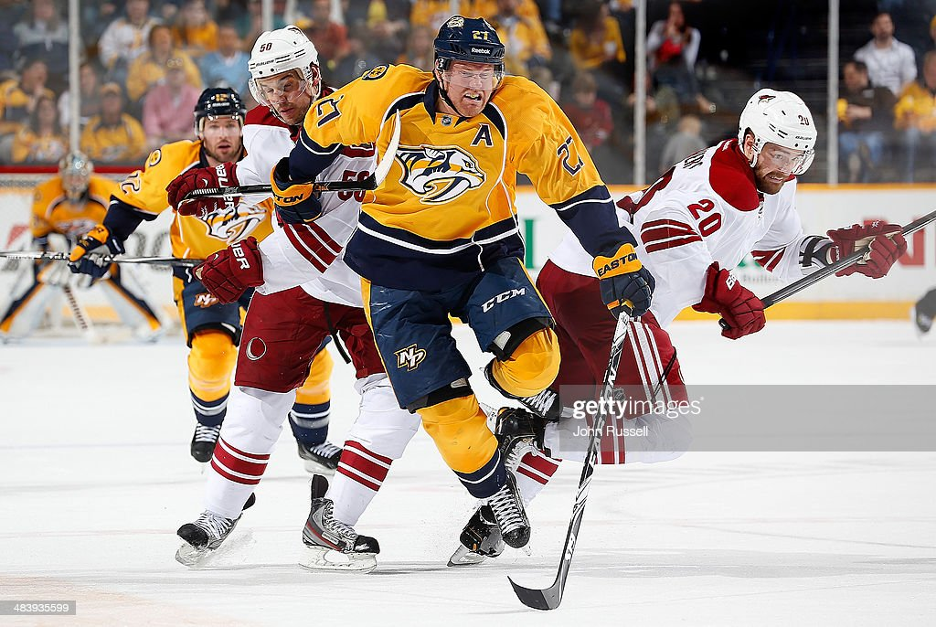 Patric Hornqvist #27 of the Nashville Predators skates for the puck against Antoine Vermette #50 and Chris Summers #20 of the Phoenix Coyotes during an NHL game at Bridgestone Arena on April 10, 2014 in Nashville, Tennessee.