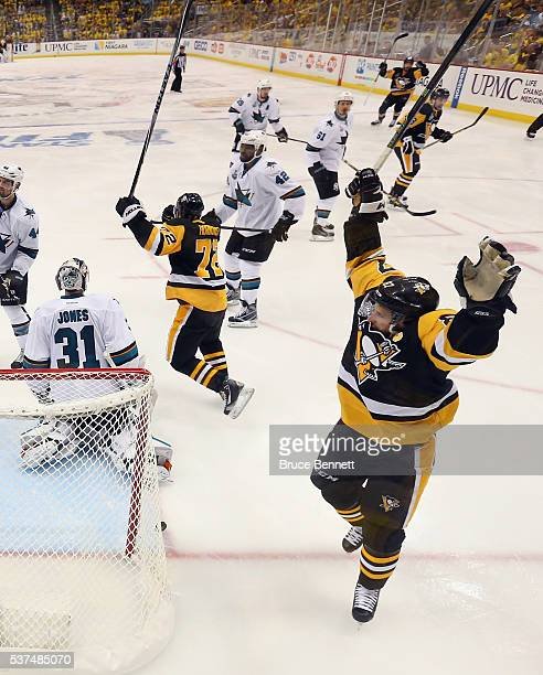 Patric Hornqvist of the Pittsburgh Penguins and Sidney Crosby celebrate after Conor Sheary scored the gamewinning goal against Martin Jones of the...