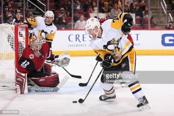 Patric Hornqvist of the Pittsburgh Penguins attempts a shot on goaltender Antti Raanta of the Arizona Coyotes during the second period of the NHL...