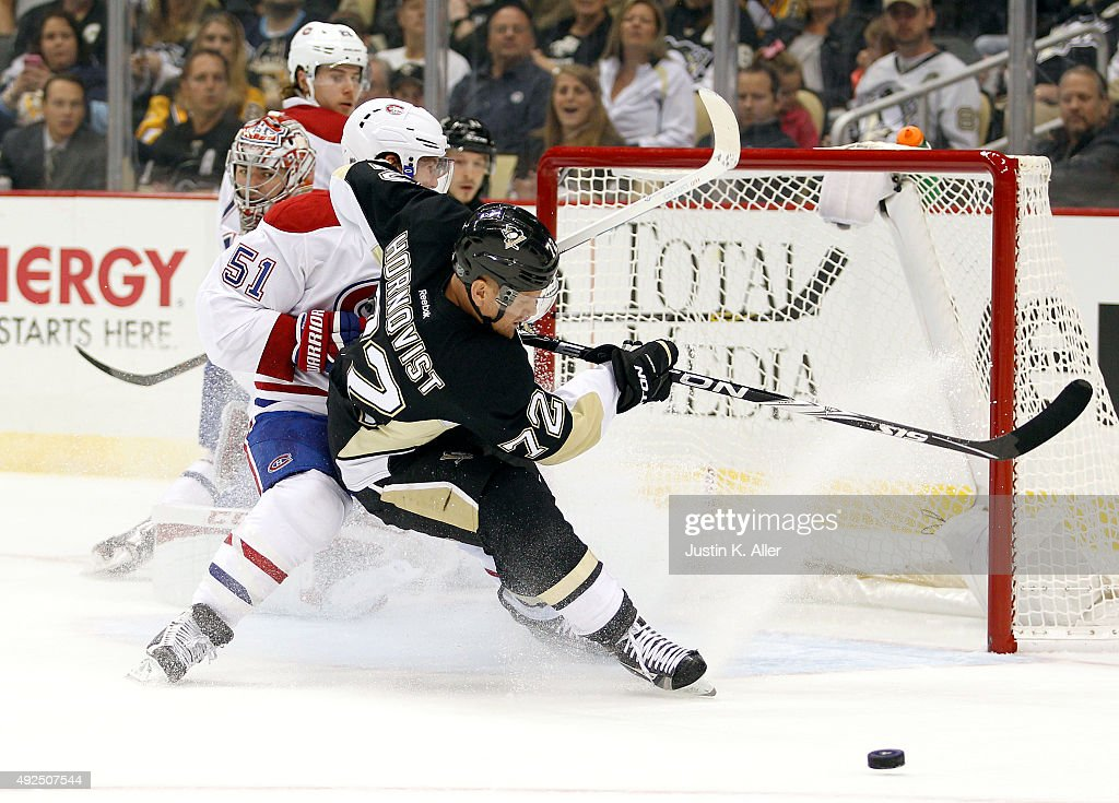 Patric Hornqvist #72 of the Pittsburgh Penguins battles David Desharnais #51 of the Montreal Canadiens in front of the net during the game at Consol Energy Center on October 13, 2015 in Pittsburgh, Pennsylvania.