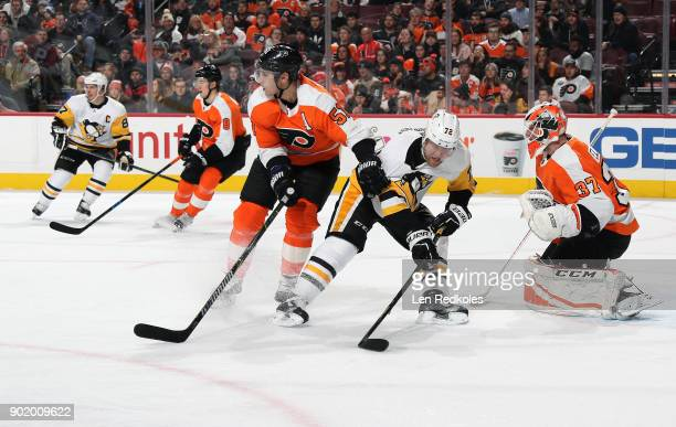 Patric Hornqvist of the Pittsburgh Penguins battles in the crease against Valtteri Filppula and Brian Elliott of the Philadelphia Flyers on January 2...