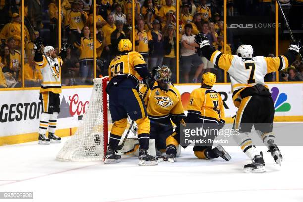 Patric Hornqvist of the Pittsburgh Penguins celebrates after scoring against Pekka Rinne of the Nashville Predators during the third period in Game...