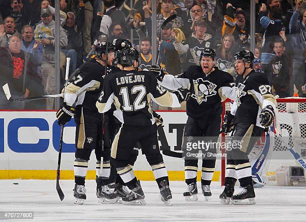 Patric Hornqvist of the Pittsburgh Penguins celebrates his goal with teammates during the first period against the New York Rangers in Game Four of...