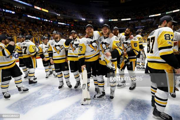 Patric Hornqvist of the Pittsburgh Penguins celebrates with Carl Hagelin after they defeated the Nashville Predators 2-0 in Game Six of the 2017 NHL...