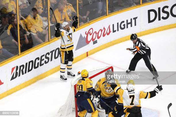 Patric Hornqvist of the Pittsburgh Penguins celebrates with teammates after scoring a goal against Pekka Rinne of the Nashville Predators during the...