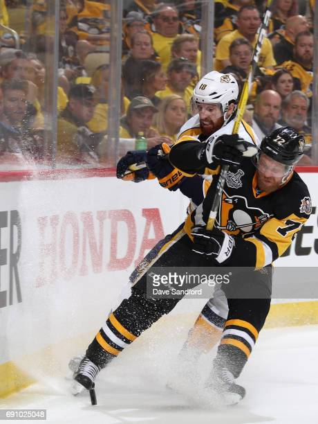 Patric Hornqvist of the Pittsburgh Penguins collides with James Neal of the Nashville Predators at the boards during the third period of Game Two of...