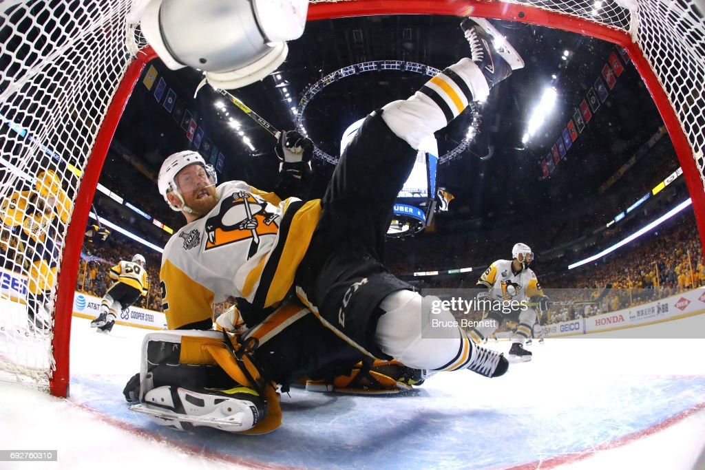 Patric Hornqvist #72 of the Pittsburgh Penguins collides with Pekka Rinne #35 of the Nashville Predators during the third period in Game Four of the 2017 NHL Stanley Cup Final at the Bridgestone Arena on June 5, 2017 in Nashville, Tennessee.