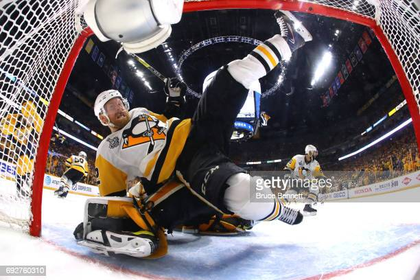 Patric Hornqvist of the Pittsburgh Penguins collides with Pekka Rinne of the Nashville Predators during the third period in Game Four of the 2017 NHL...