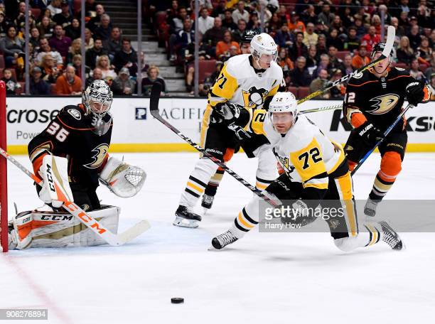 Patric Hornqvist of the Pittsburgh Penguins dives for a pass in front of John Gibson of the Anaheim Ducks during the second period at Honda Center on...