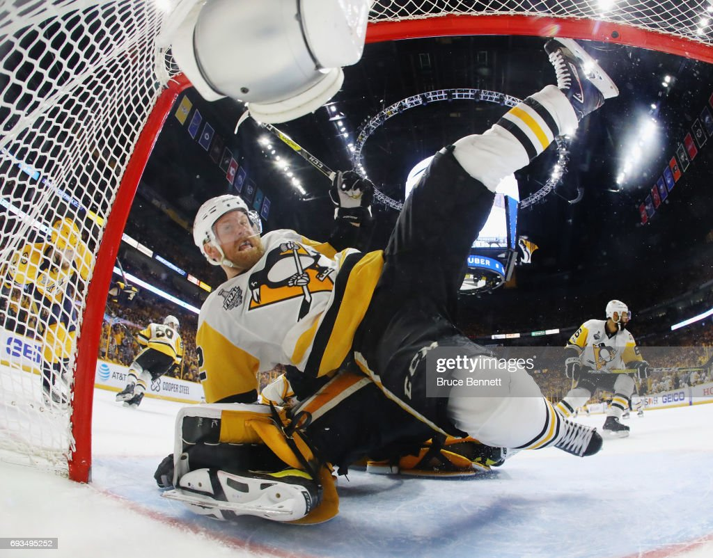 Patric Hornqvist #72 of the Pittsburgh Penguins falls on Matt Murray #30 during the game against the Nashville Predators in Game Four of the 2017 NHL Stanley Cup Final at the Bridgestone Arena on June 5, 2017 in Nashville, Tennessee.