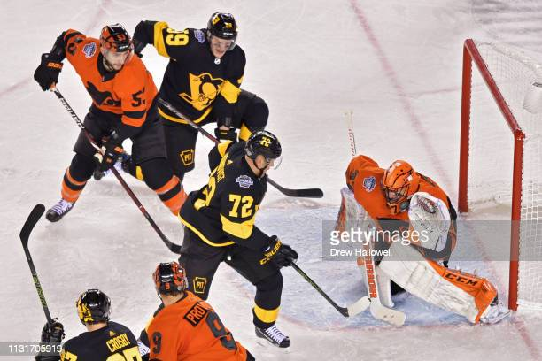 Patric Hornqvist of the Pittsburgh Penguins gets a shot past Brian Elliott of the Philadelphia Flyers for a goal in the second period during the 2019...