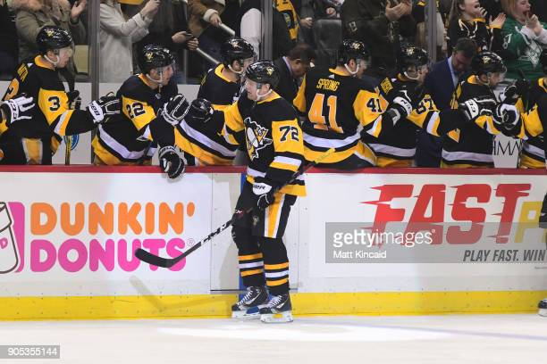 Patric Hornqvist of the Pittsburgh Penguins is congratulated after scoring a goal against the New York Rangers at PPG PAINTS Arena on January 14 2018...