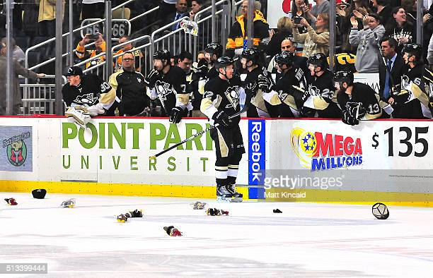 Patric Hornqvist of the Pittsburgh Penguins is congratulated by his bench after scoring a goal to give him a hat trick against the Arizona Coyotes at...