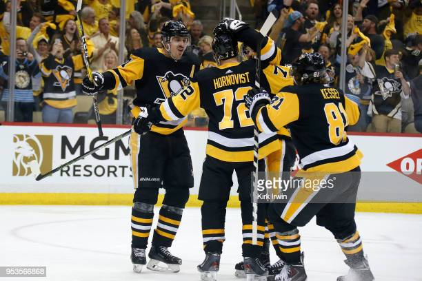 Patric Hornqvist of the Pittsburgh Penguins is congratulated by his teammates after scoring a power play goal during the second period in Game Three...