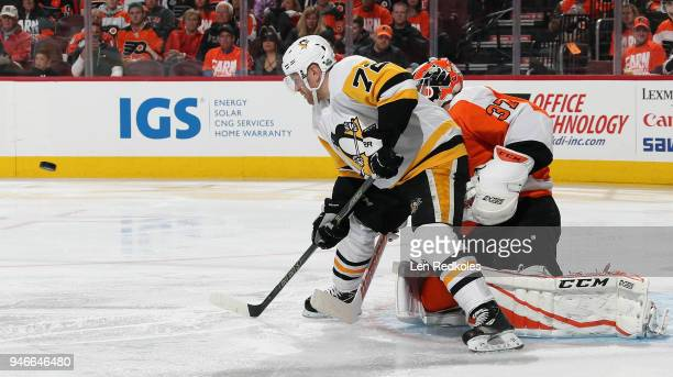 Patric Hornqvist of the Pittsburgh Penguins prepares to deflect the airborn puck against Brian Elliott of the Philadelphia Flyers in Game Three of...