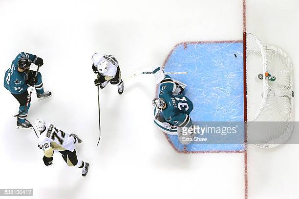 Patric Hornqvist of the Pittsburgh Penguins scores a goal against Martin Jones of the San Jose Sharks during the second period in Game Three of the...