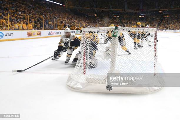 Patric Hornqvist of the Pittsburgh Penguins scores a goal against Pekka Rinne of the Nashville Predators during the third period in Game Six of the...