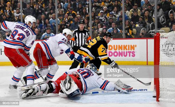 Patric Hornqvist of the Pittsburgh Penguins scores past Henrik Lundqvist of the New York Rangers in the first period at PPG Paints Arena on January...